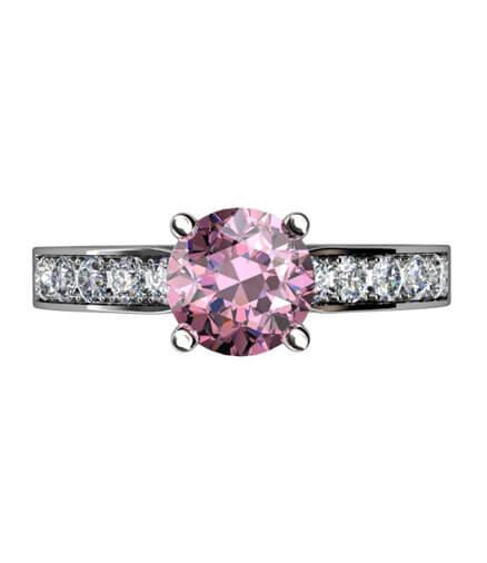 Ring i vitguld med briljantslipade diamanter och rosa spinell