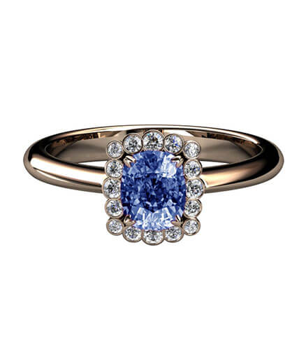 färgsprakande förlovningsring med safir och diamanter