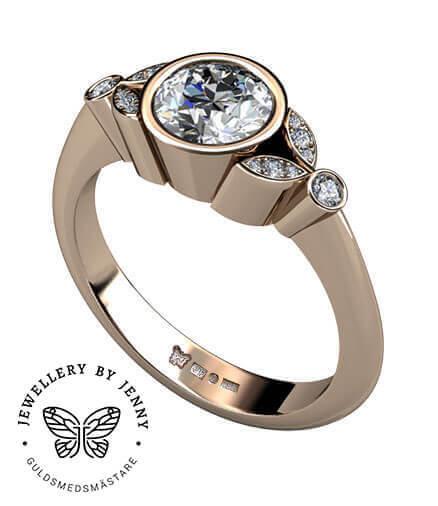 förlovningsring i rödguld med diamanter