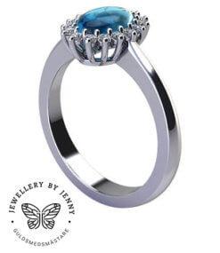 Haloring med diamanter och blå ädelsten